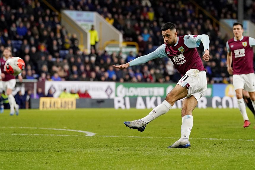Burnley's Dwight McNeil shoots at goal in Britain on March 7, 2020.
