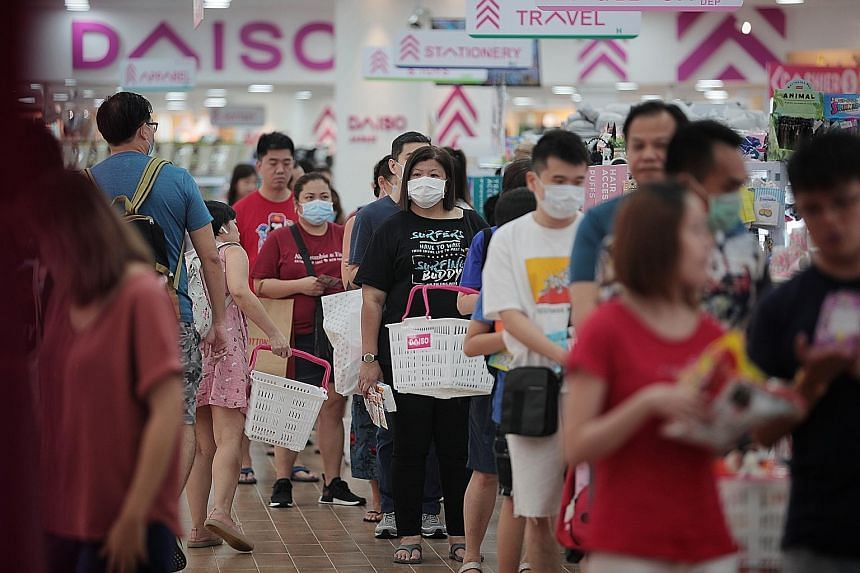 At malls like VivoCity yesterday, queues could be seen outside Toys 'R' Us, Popular and Challenger outlets as parents bought books, toys and laptops to prepare their children for home-based learning from Wednesday.