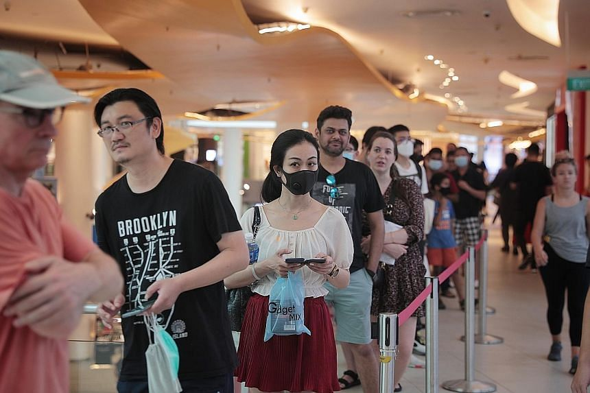 A bustling crowd did not seem to be observing safe distancing rules at Geylang Serai Market yesterday, and the same was true at other wet markets around Singapore as people shopped for fresh cuts of meat and seafood.