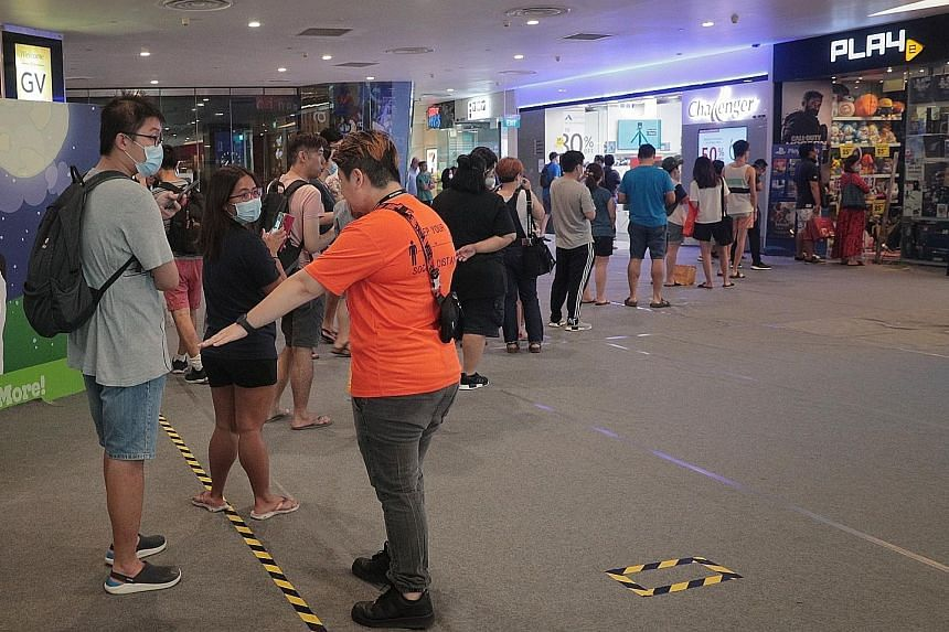 Many Singaporeans went out yesterday to stock up on things they needed or wanted, in anticipation of non-essential businesses having to shut from Tuesday until May 4 to curb the spread of the coronavirus. In VivoCity, long queues of customers were se