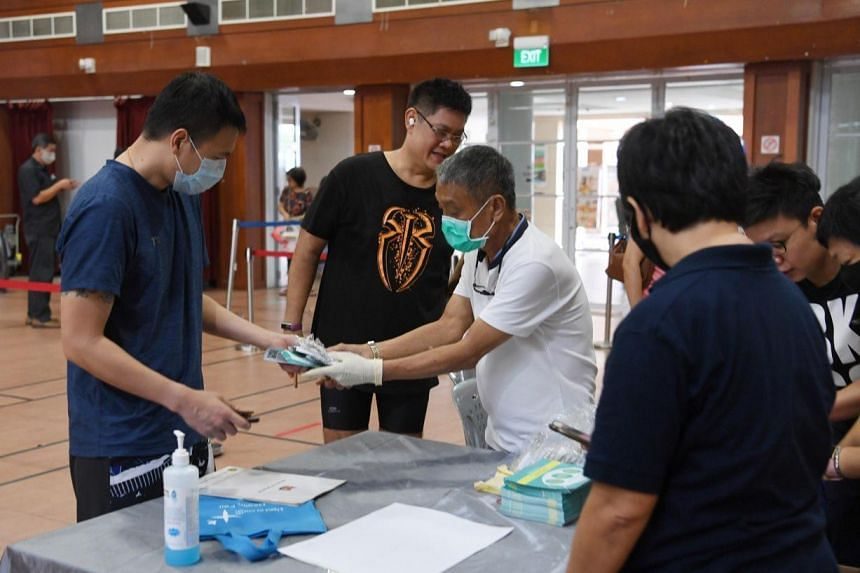 Residents collecting masks at Potong Pasir Community Centre on April 5, 2020.
