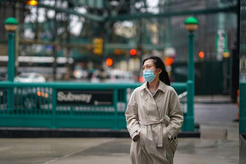 Stony Brook University student Zhaojing Qian worries about getting on a plane with others who might get infected.