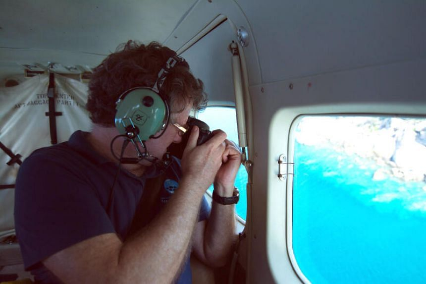 Coral scientist Professor Terry Hughes conducting aerial surveys of Australia's Great Barrier Reef.