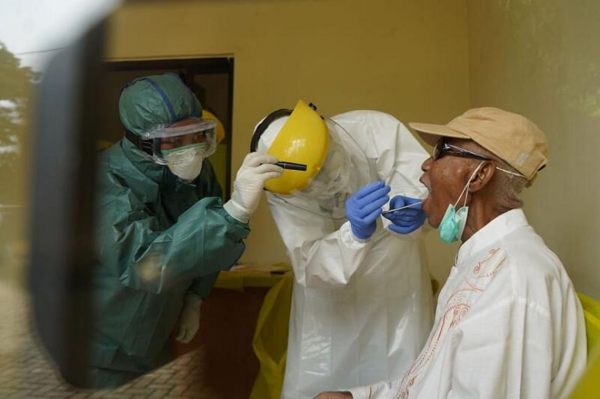 An Indonesian medical team takes a swab in Indonesia on April 6, 2020.