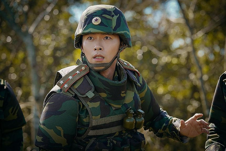 South Korean actor Hyun Bin (left) played a dashing North Korean captain in hit Korean drama Crash Landing On You. But another South Korean actor, the burly Ma Dong-seok (left below), is said to be a more accurate example of an attractive man in the