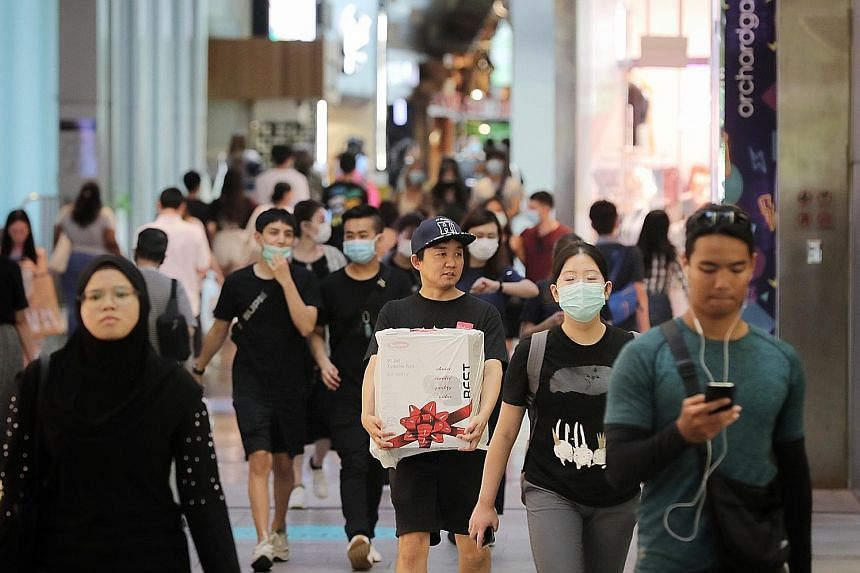 """MP Liang Eng Hwa said yesterday in Parliament that he believes """"we will eventually have a Victory Budget in time to come"""". PHOTO: GOV.SG Shoppers at Orchard Central yesterday. This week, Singapore will shut down all schools and most workplaces as it"""