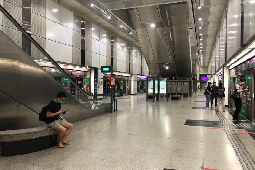An unusually quiet Dhoby Ghaut MRT station at 10.45am on April 7, 2020.