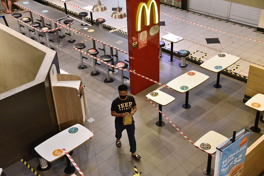 A customer exiting the McDonald's outlet  at Parklane Shopping Mall on April 7, 2020.