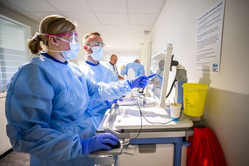 Nurses prepare medicines for a coronavirus patient at a hospital in The Hague on April 4, 2020.