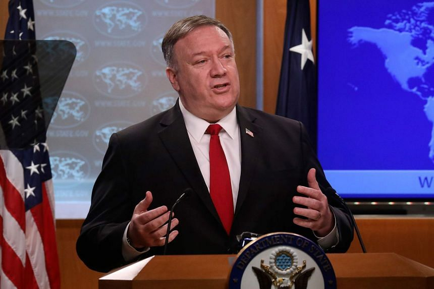 Mike Pompeo addresses a news conference at the State Department in Washington, April 7, 2020.