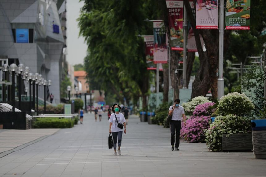 """Pedestrians in Orchard Road at around 5.30pm on April 7, on the first day of Singapore's """"circuit breaker"""" mode."""