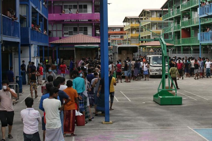 Workers queueing to collect food and drinks at S11 Dormitory @ Punggol on April 6, 2020.