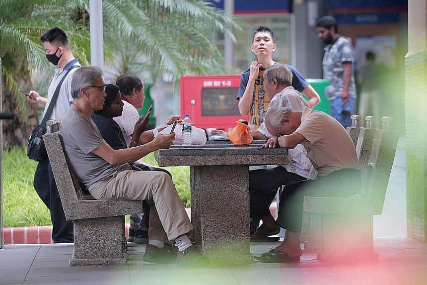 People gathering in Jalan Besar at around 12.30pm yesterday, the first day the circuit-breaker measures took effect. Under the new law, social gatherings with friends and relatives who do not live together are banned, though individuals can still vis
