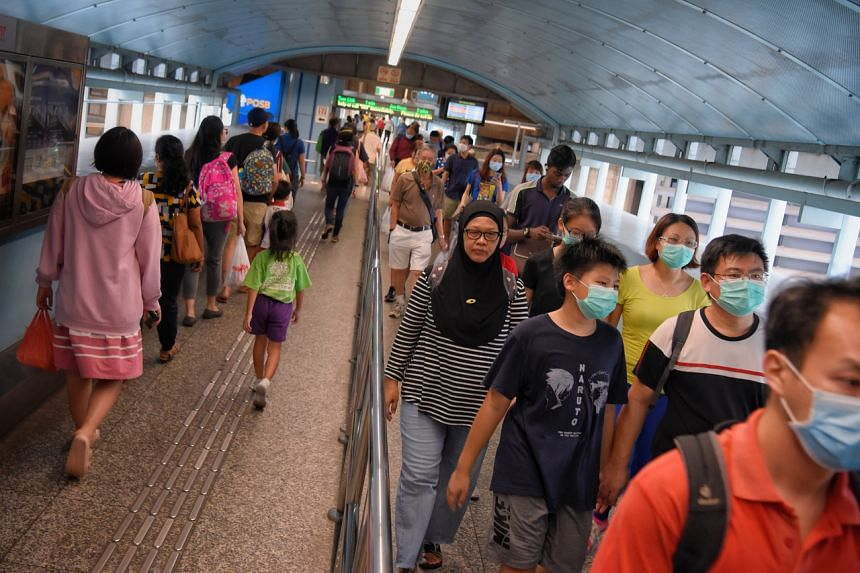 Commuters at Clementi MRT Station on April 7, 2020.