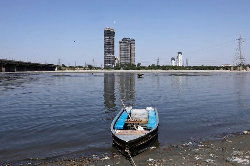 A boat is seen on the banks of the river Yamuna in New Delhi on April 8, 2020.