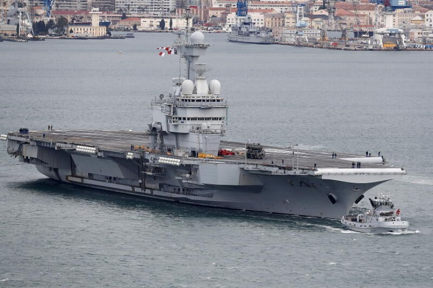 French aircraft carrier ends mission amid possible outbreak