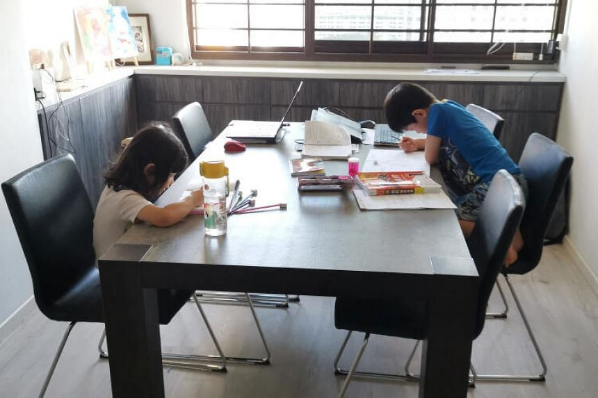 Kevin Yu, seven, with his sister, Nicole, four, on his first day of full home-based learning on April 8, 2020.