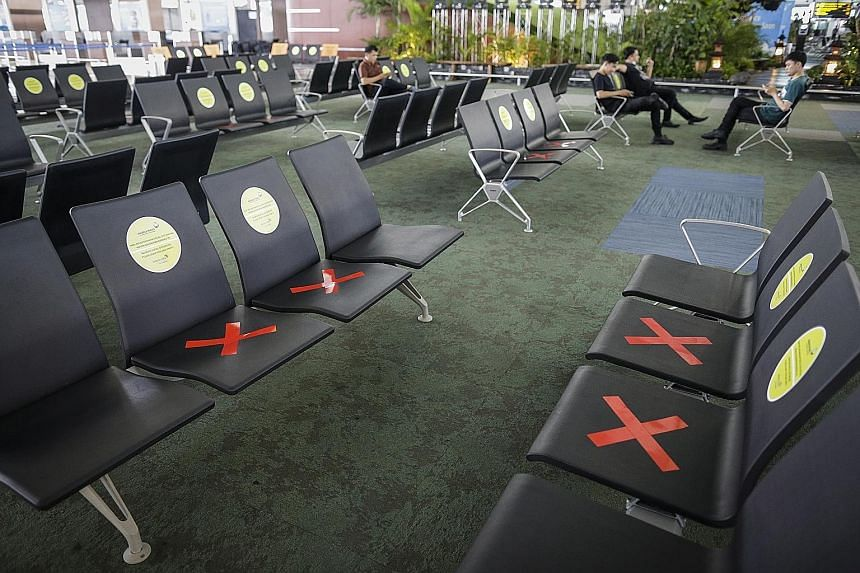 Benches are marked to remind people to practise social distancing to stop the spread of the coronavirus, at the check-in lounge of an almost-empty Soekarno-Hatta International Airport in Tangerang, Indonesia, on Tuesday. PHOTO: EPA-EFE