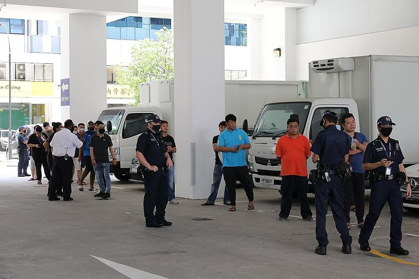 One Grab driver estimated that there were about 300 to 400 people in the queue when she arrived at the centre at 10.30am.