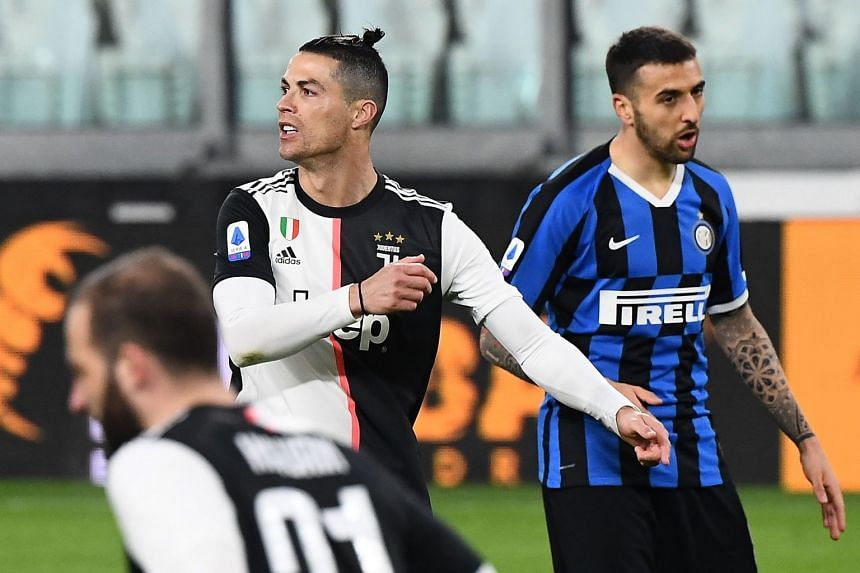 Cristiano Ronaldo (left) in action for Juventus against Inter Milan on March 8, 2020.