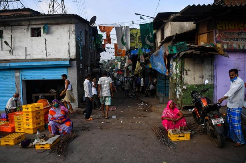 People are seen in the Dharavi slum in Mumbai on April 6, 2020.