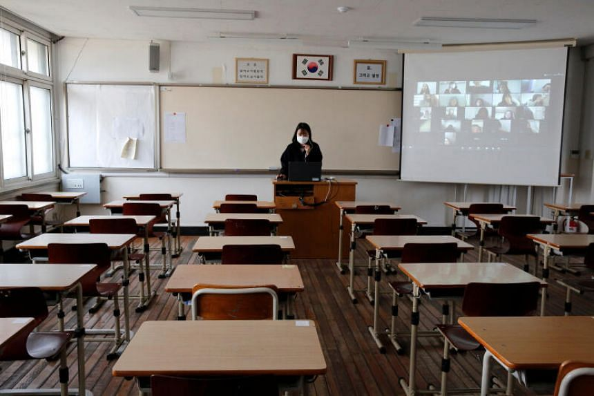 A teacher conducts an online class at a high school in Seoul on April 9, 2020.