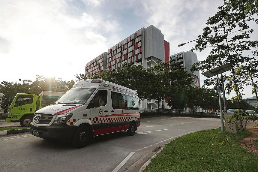 An ambulance yesterday leaving Sungei Tengah Lodge, which is the fourth foreign worker dormitory to be declared an isolation area. The facility is among foreign worker dorms where clusters of Covid-19 infection have emerged.