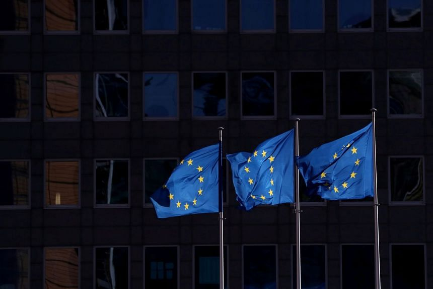 European Union flags fly outside the European Commission headquarters in Brussels on Feb 19, 2020.