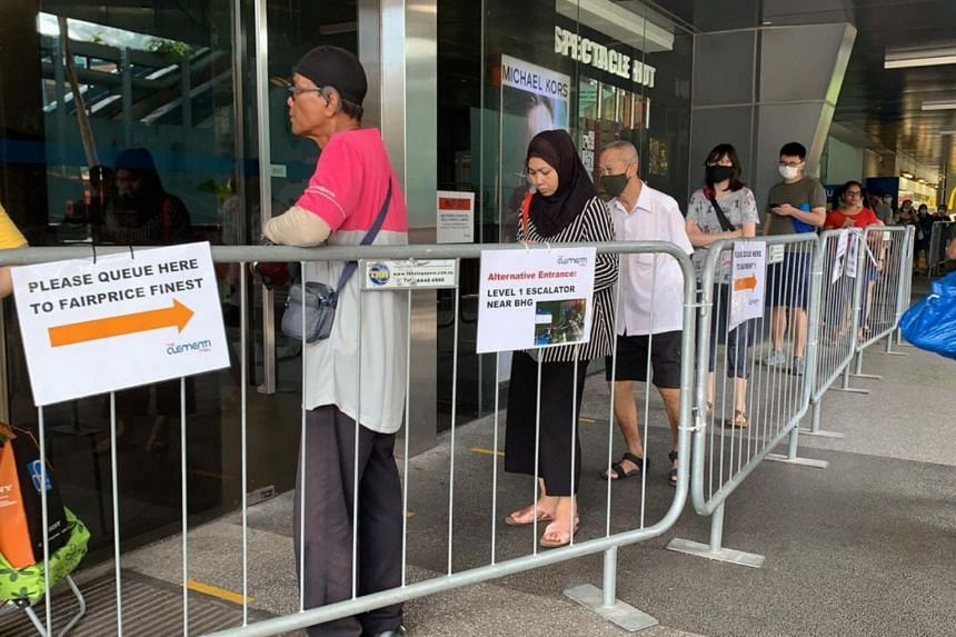 A queue forms outside Clementi Mall for shoppers entering FairPrice Finest on April 10, 2020.
