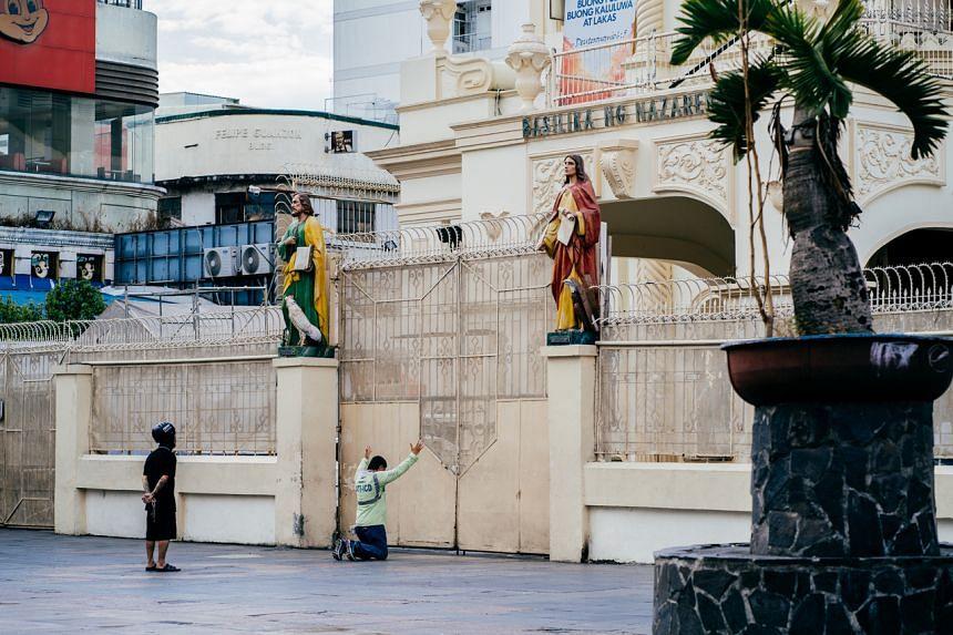 Devotees outside Manila's Quiapo church on April 10, 2020.