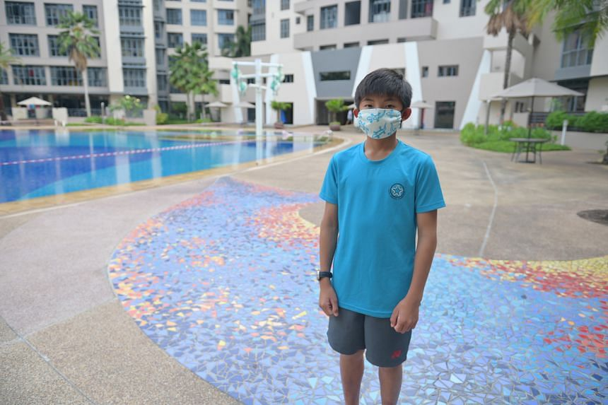 National sailor Kenan Tan, 12, fashioned a mask out of a cotton handkerchief.