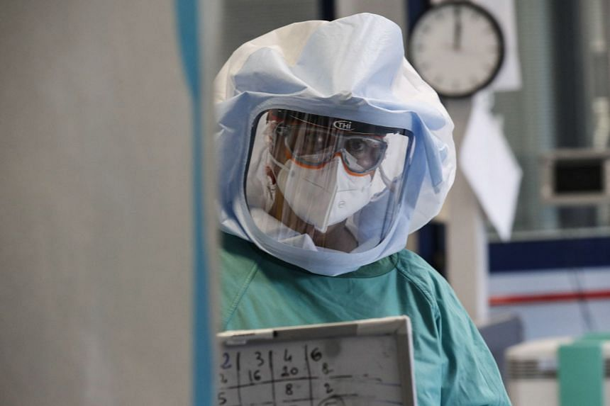 A healthcare professional works in the intensive care unit of a hospital in Rome, Italy, April 10, 2020.