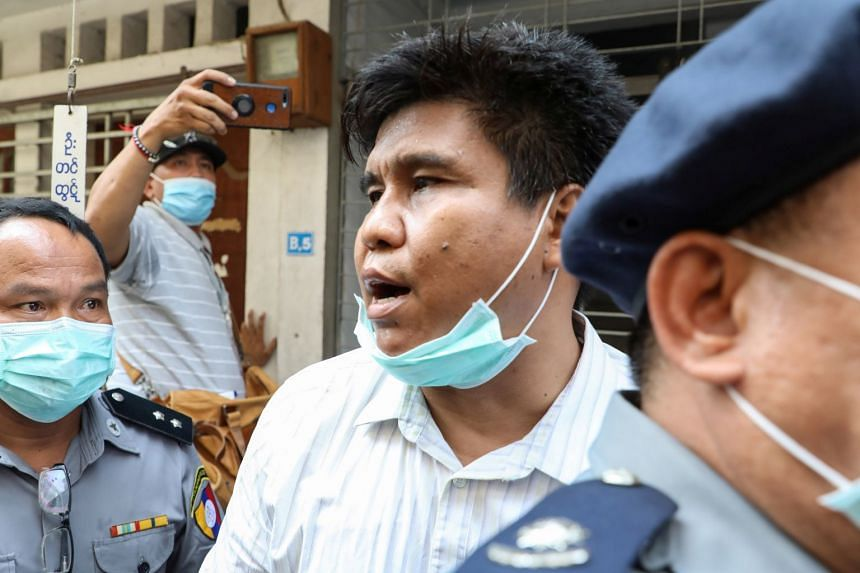 Nay Myo Lin is escorted to court by police on March 31, 2020.
