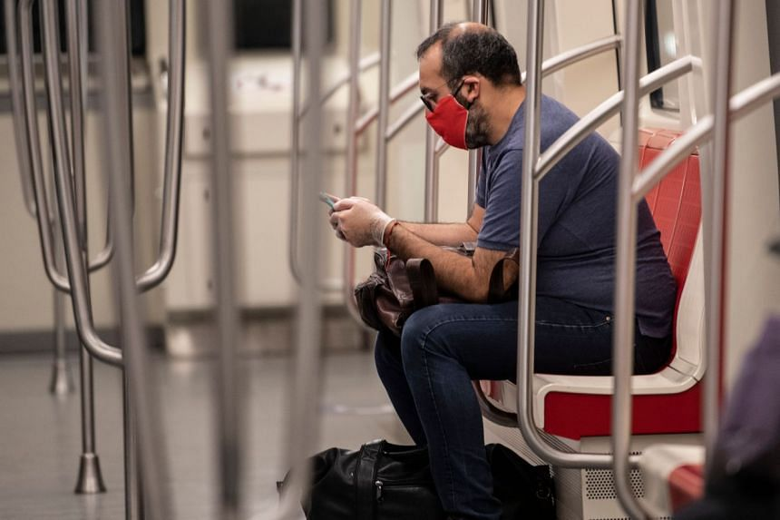 A commuter uses his mobile phone on the subway in Santiago, Chile, on April 8, 2020.