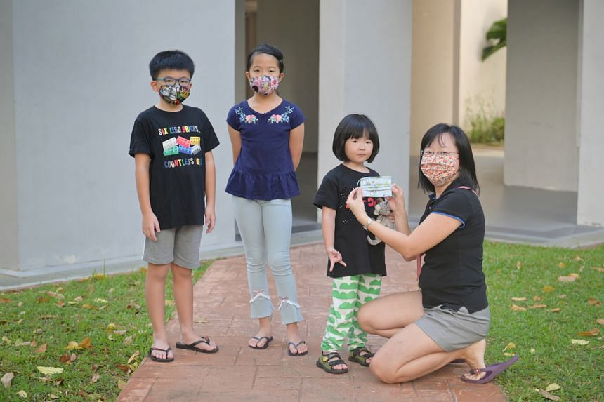 Home-based crafter Jacquelene Pang (right) adapted various mask designs to fit children and toddlers as many parents are unable to find masks for their kids.