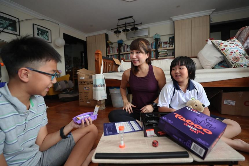 Ms Yvonne Kong-Ho (middle) joins her children, Gabriel and Natalie, for a game of Taboo.