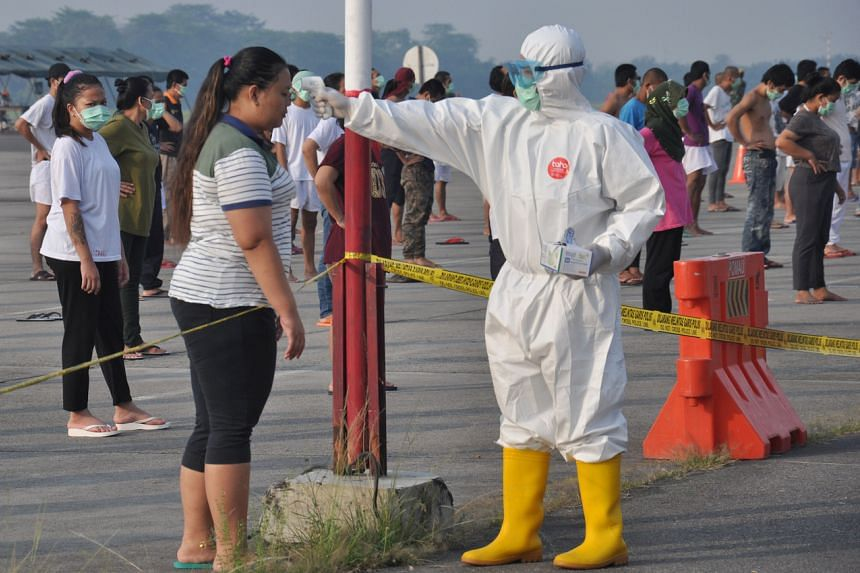 An officer wearing protective gear in Indonesia on April 11, 2020.