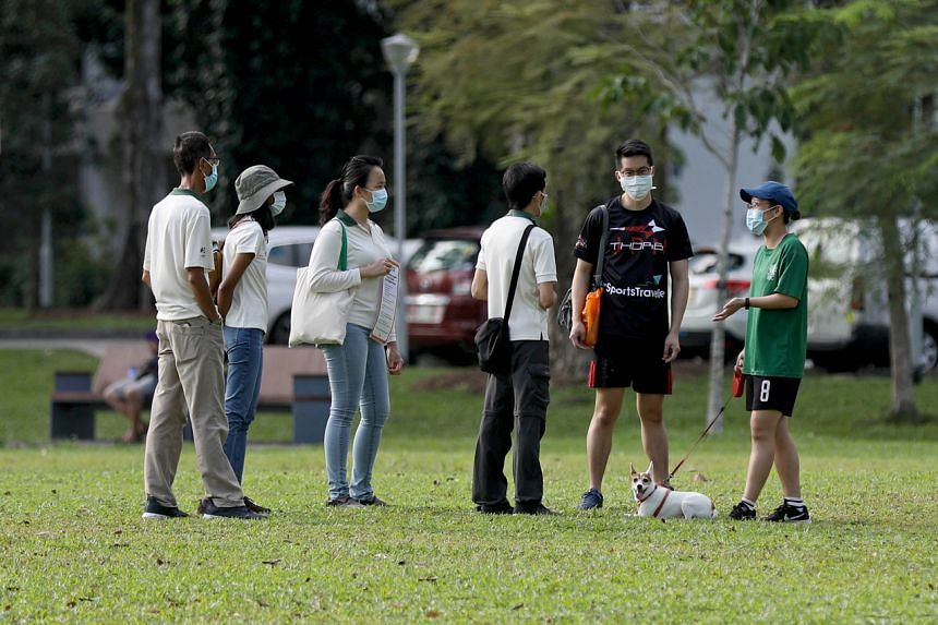 NParks officers speaking to a couple at Bishan-Ang Mo Kio Park on April 10, 2020.