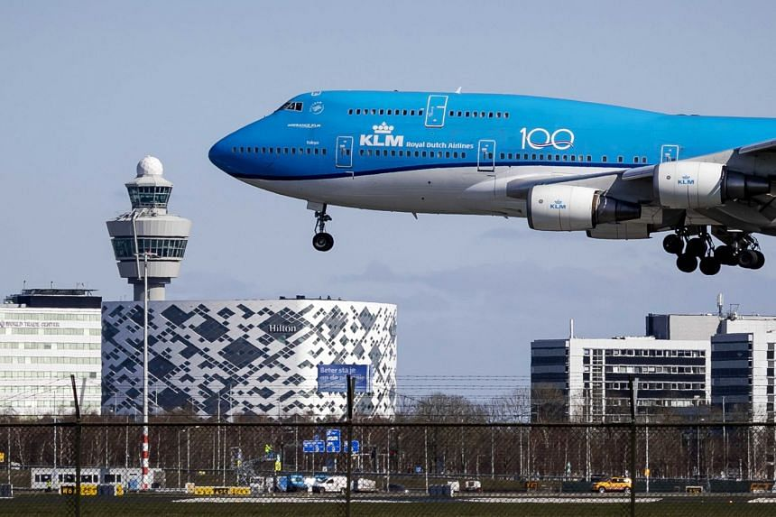 A Royal Dutch Airlines KLM plane landing at Schiphol Airport on March 29, 2020.