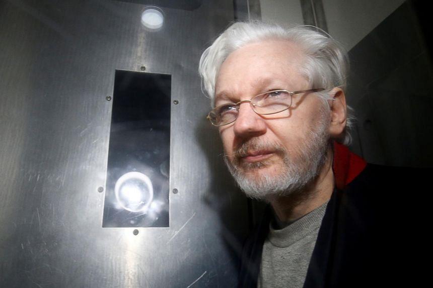 In a photo taken on Jan 13, 2020, WikiLeaks' founder Julian Assange leaves Westminster Magistrates Court in London.