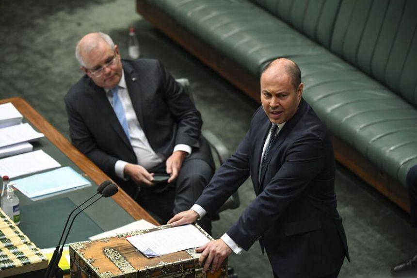 Australian Prime Minister Scott Morrison and Treasurer Josh Frydenberg are seen during a Parliament session in Canberra on April 8, 2020.