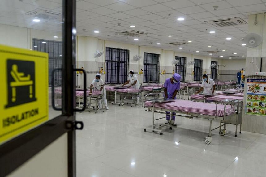 Medical staff prepare an isolation ward at a newly inaugurated hospital in Chennai, India, on March 27, 2020.
