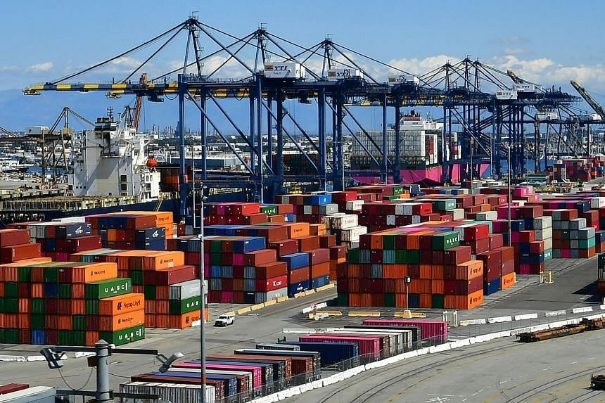 Containers at the Port of Los Angeles last month. The port saw a 31 per cent drop in volume last month, compared with a year ago, as retailers scaled back orders. PHOTO: AGENCE FRANCE-PRESSE