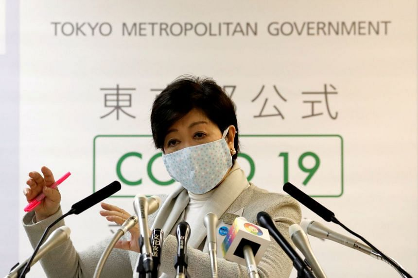 Japan's Abe leans toward blanket cash payouts to fight coronavirus downturn