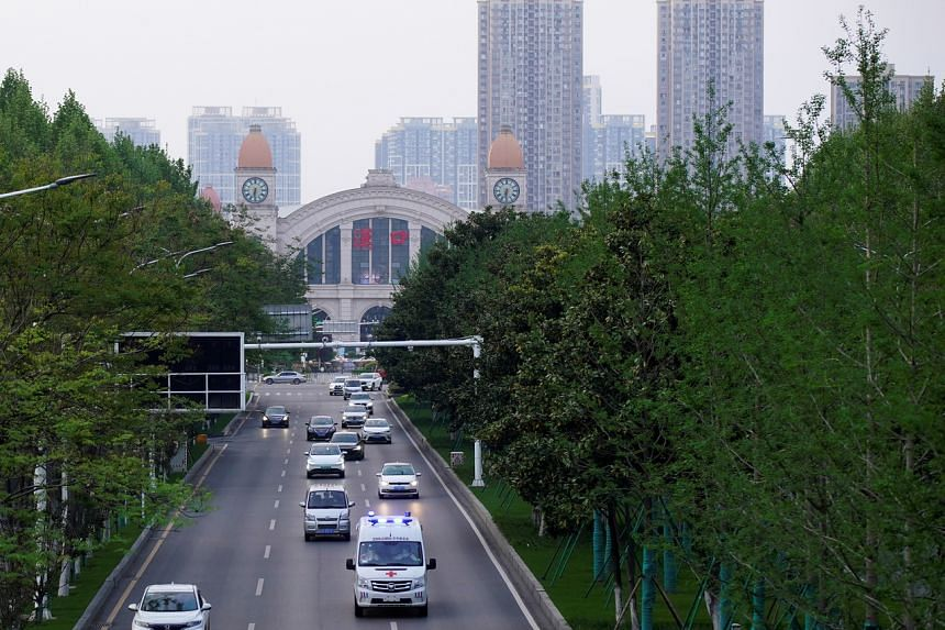 Traffic is seen on a road in front of Hankou Railway Station in Wuhan on April 9, 2020.