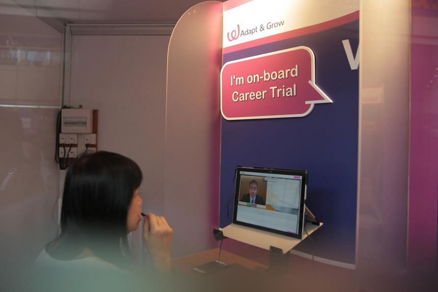 A job-seeker during a video interview at the Adapt and Grow Career Fair at the HDB Hub on July 2, 2019.