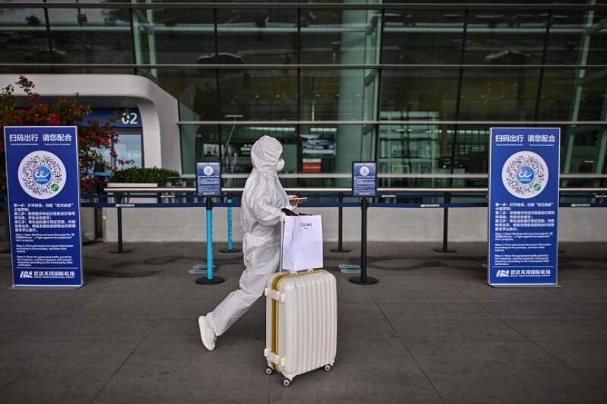 A passenger at Tianhe Airport in Wuhan, China, on April 11, 2020.