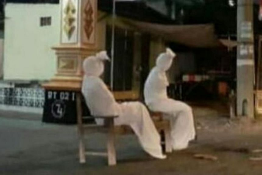 """Kepuh village on Java island has deployed a cast of """"ghosts"""" to patrol the streets."""