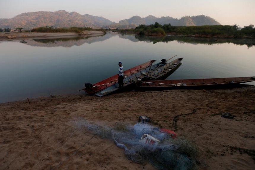 A fisherman is seen on the Mekong river bank outside Nong Khai, Thailand, on Jan 10, 2020.