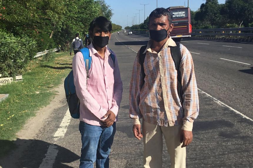 Mr Sanjay Kumar (left) with a relative at an expressway in Noida, India, on March 28, 2020.
